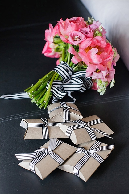 kraft boxes with black striped ribbon