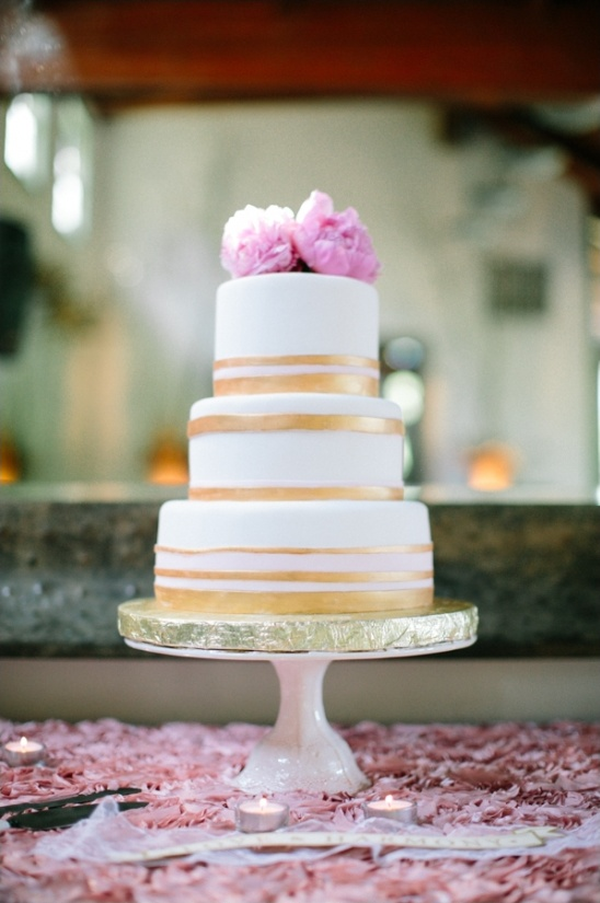 gold, white and pink wedding cake by Village Bakery