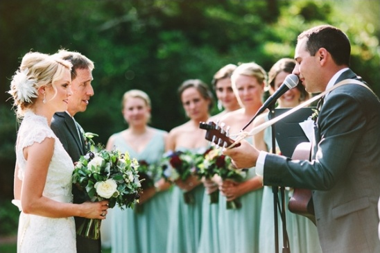 groom serenading the bride as she walks down the aisle