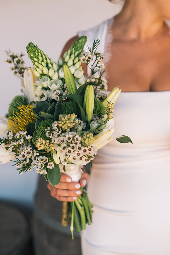 white and green wedding bouquet by pink rose pretty girl