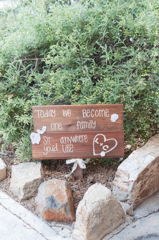 wooden ceremony welcome sign