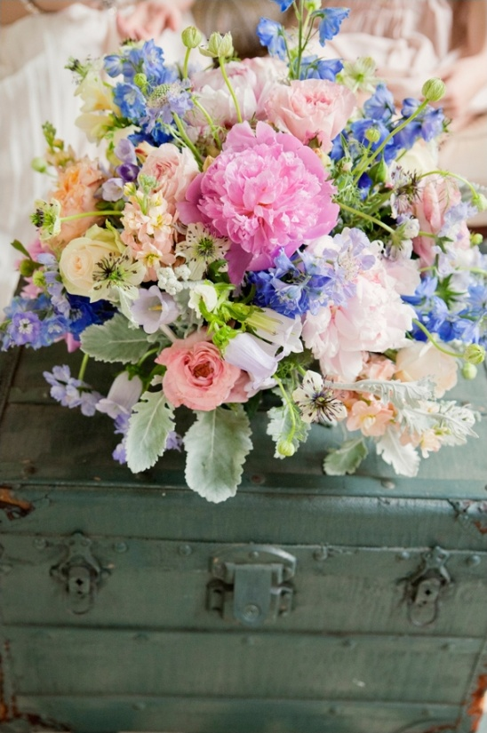 colorful floral arrangement by embellished blooms