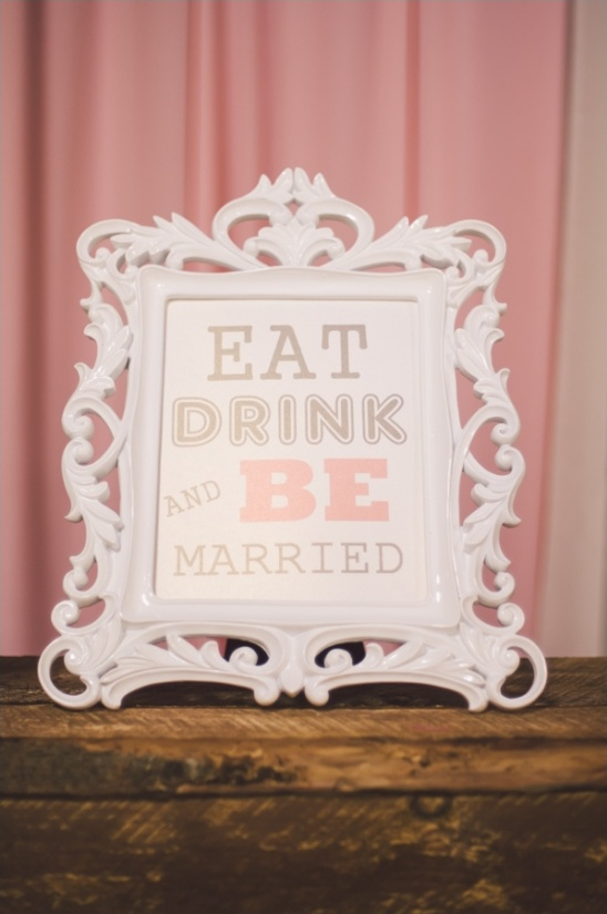 pink and white eat drink and be married sign