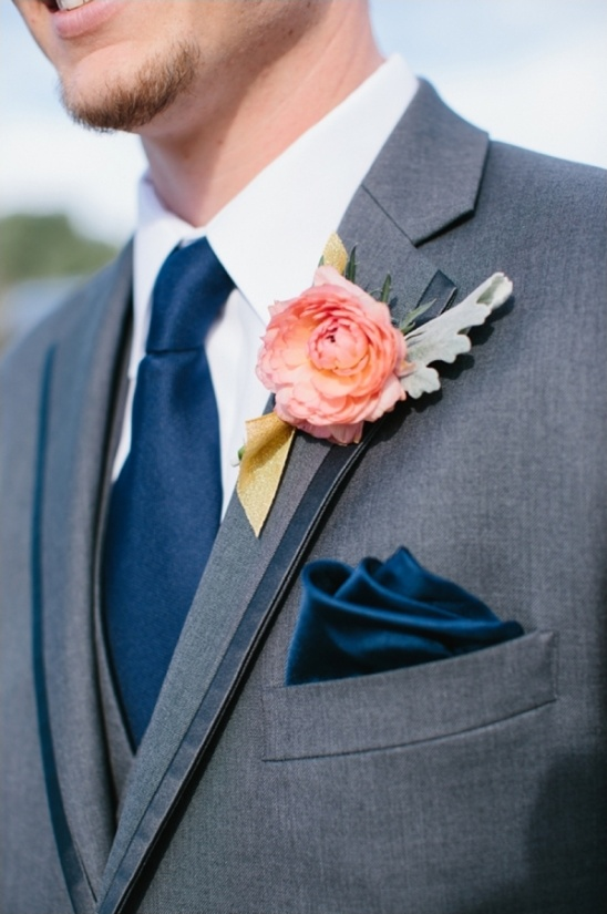 navy blue and peach boutonniere