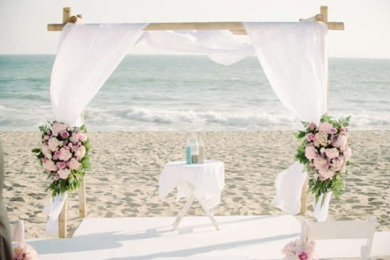 Malibu beach wedding in pink and white beach wedding ceremony decor ideas wedding arch floral arrangement junglespirit Choice Image