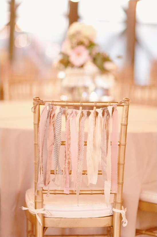 gold chairs with ribbons