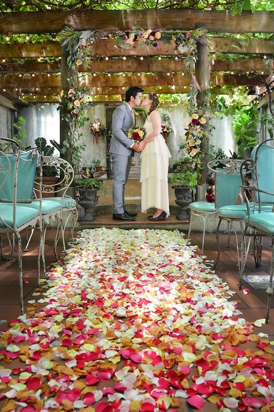 ombre petal covered ceremony aisle