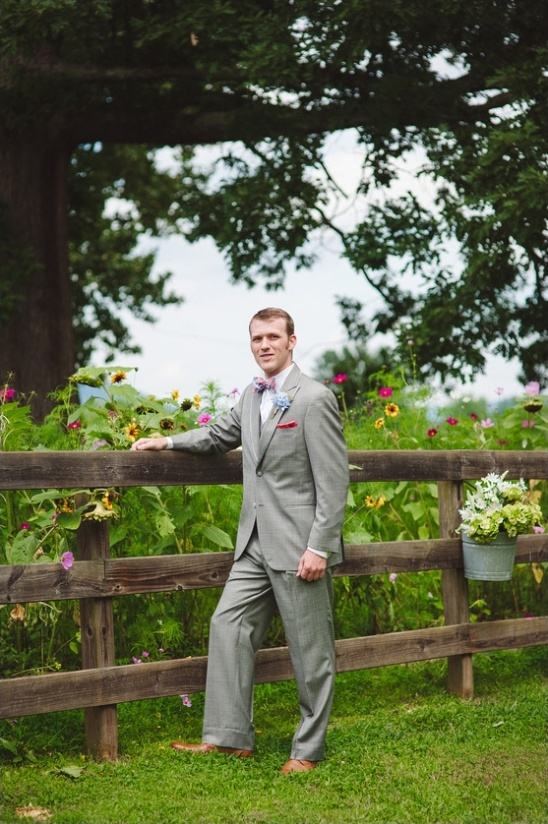 groom in gray suit and bow tie