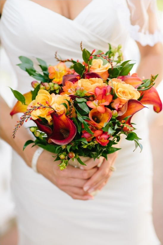 orange and yellow bouquet by festive designs