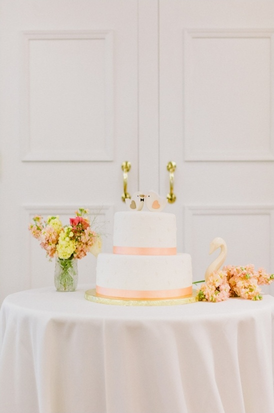 simple peach and white cake by the cakemaker