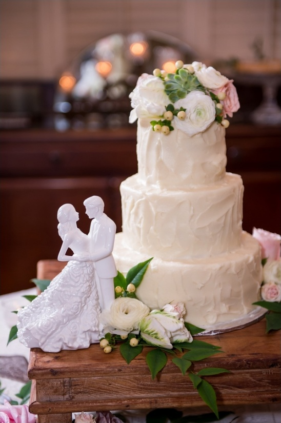 white wedding cake with flowers by patty cakes