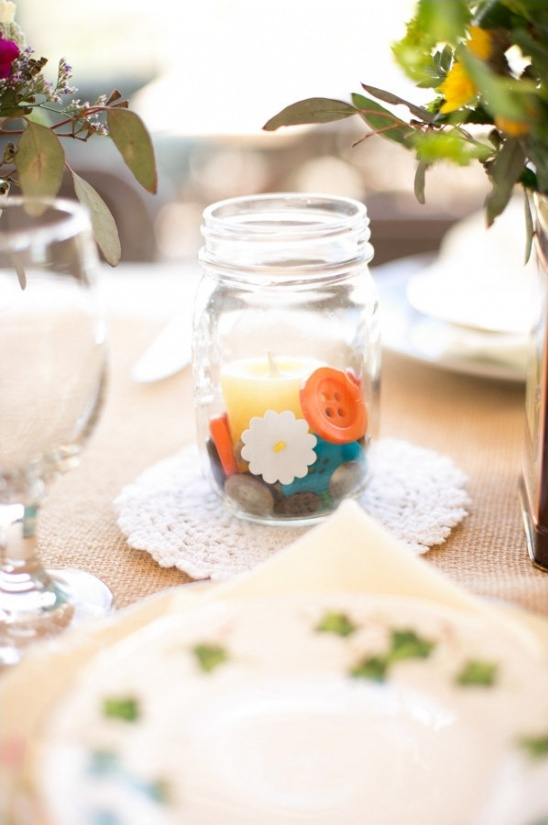 mason jar with buttons and candle