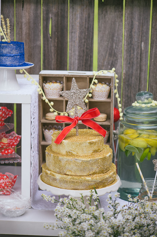 glittery gold wedding cake with silver star cake topper