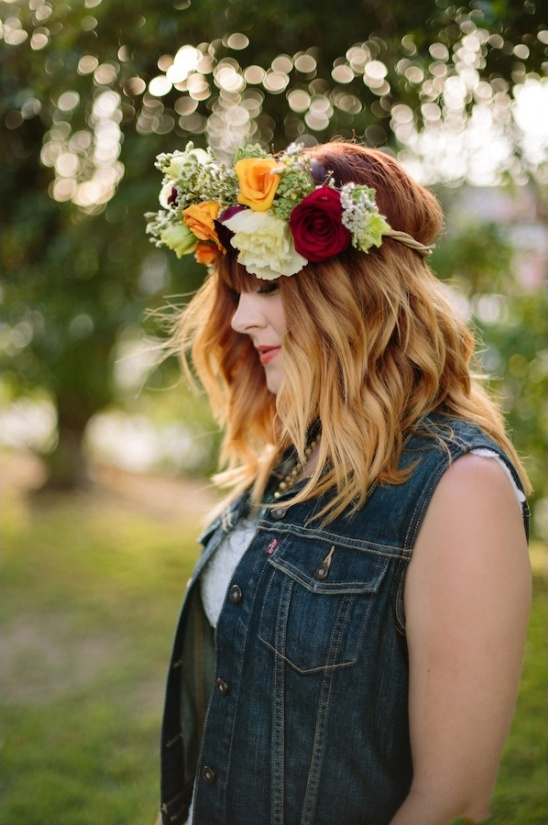 bride in jean jacket with wedding halo