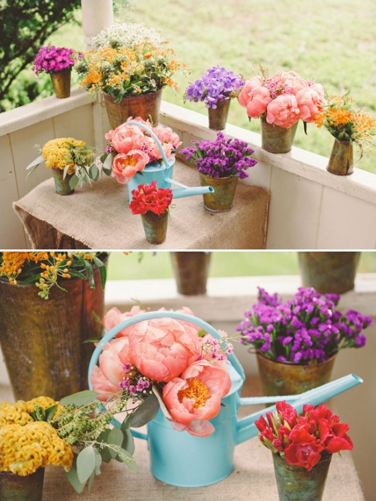 aqua watering can floral arraignments