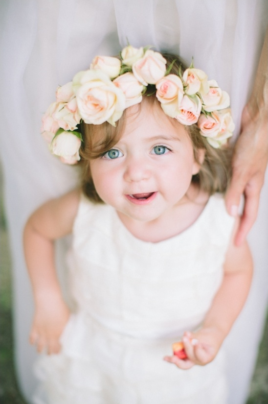 adorable flower girl with roses in her hair
