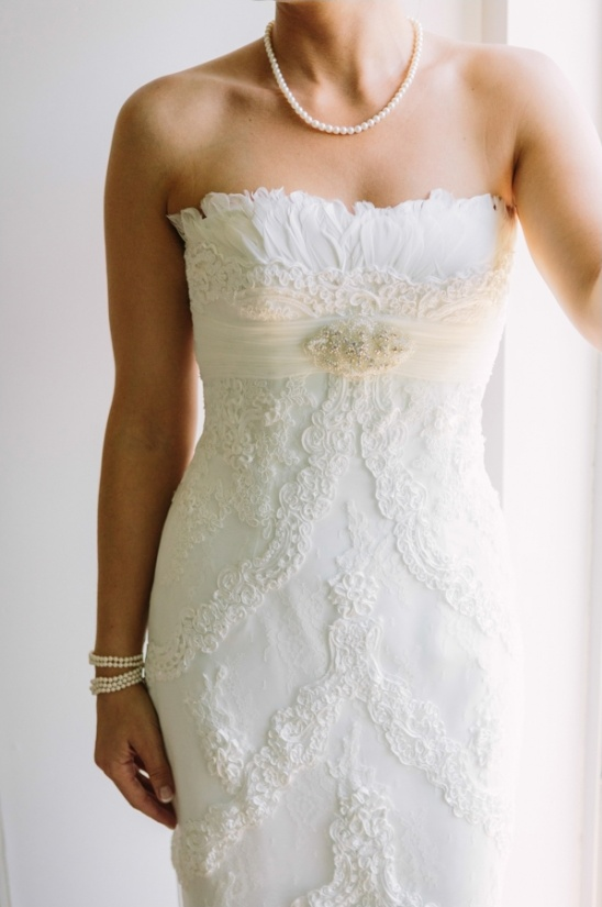 pronovias strapless wedding dress with feather top