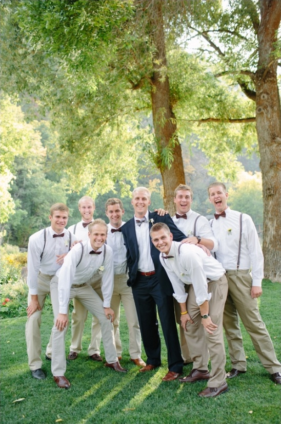 bow ties and suspenders on groomsman
