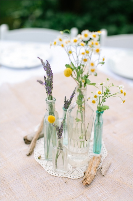 glass bottles with wild flowers