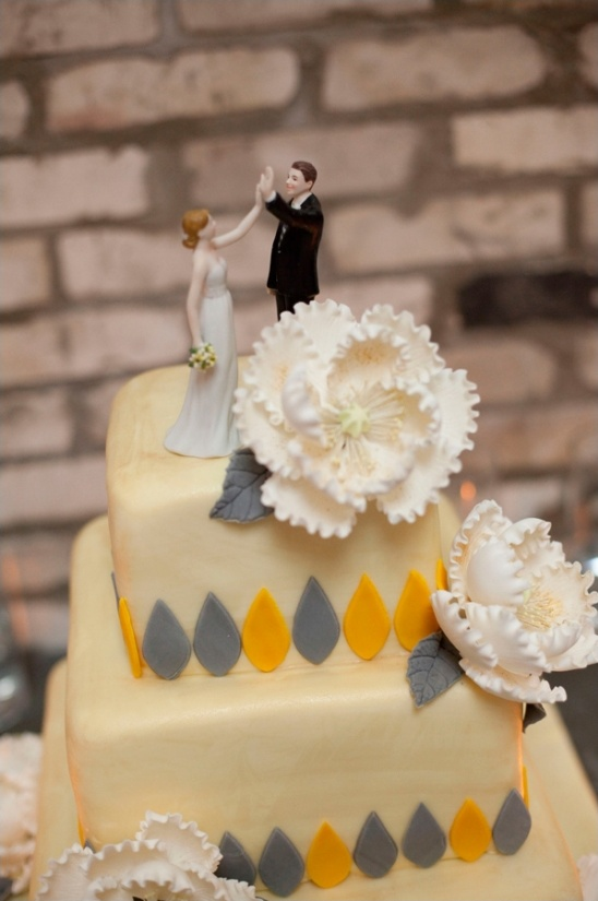 high fiving bride and groom cake topper
