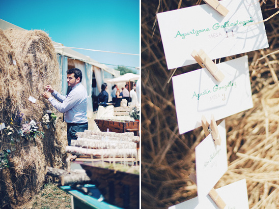 escort cards hanging from hay barrel