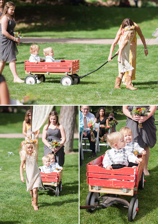 ring bearers in a red wooden wagon