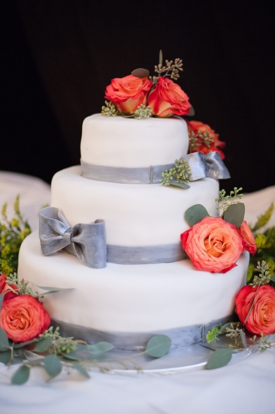gray and white cake with rose decorations