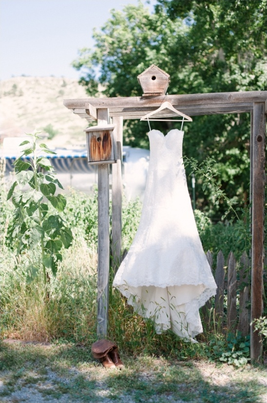 lace wedding gown with cowgirl boots
