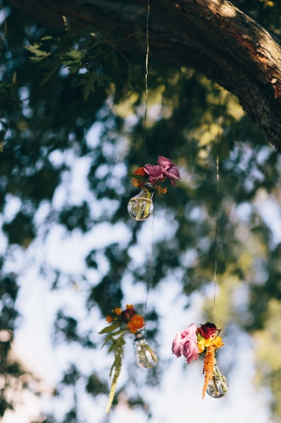 hanging lightbulbs holding flowers