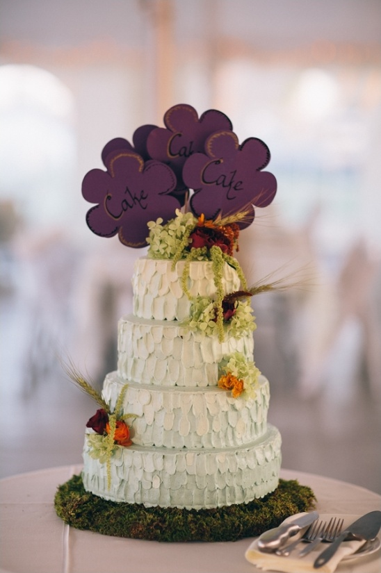 wedding cake with purple flower cake topper