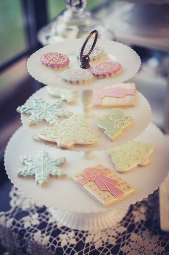 frosted holiday cookies on vintage dessert display