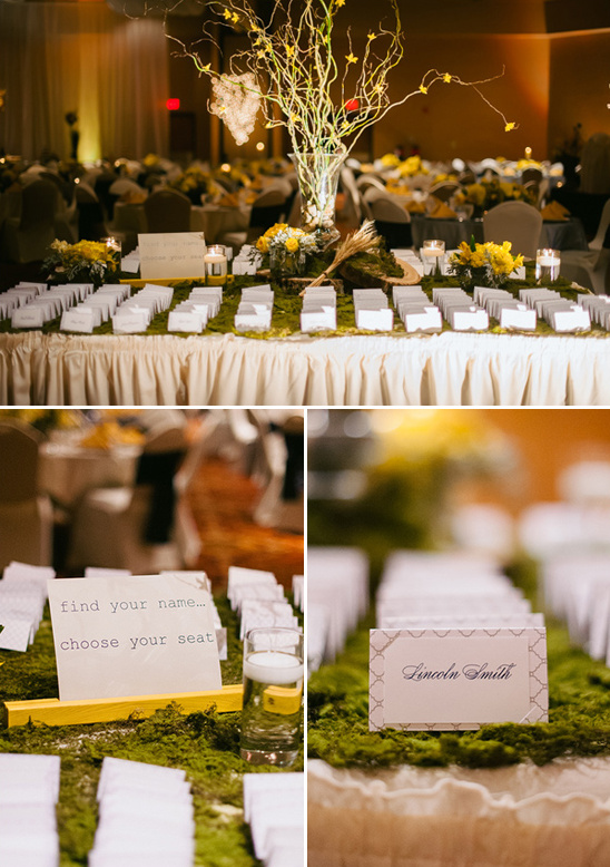 escort card table covered in moss