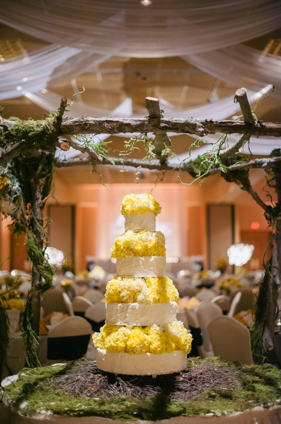 yellow and white wedding cake by mary b's cakes
