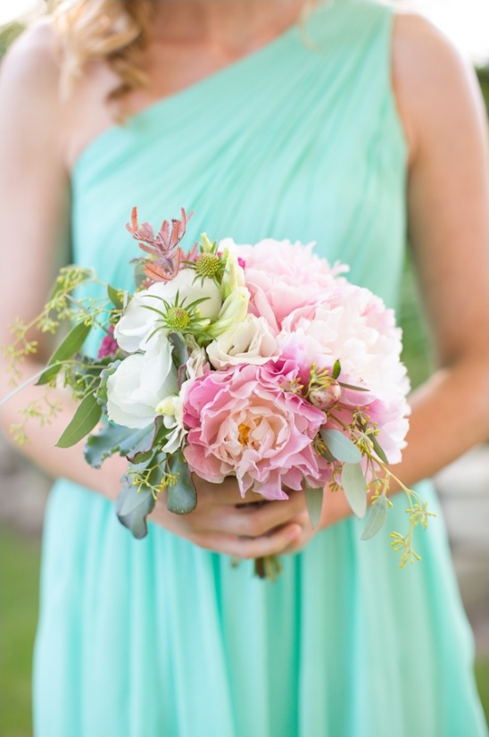teal bridesmaid dress and pink and white bouquet