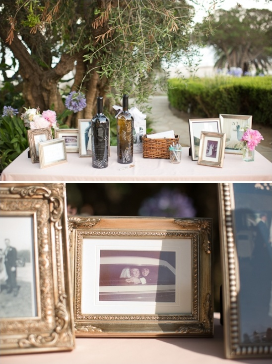 welcome table with framed family photos