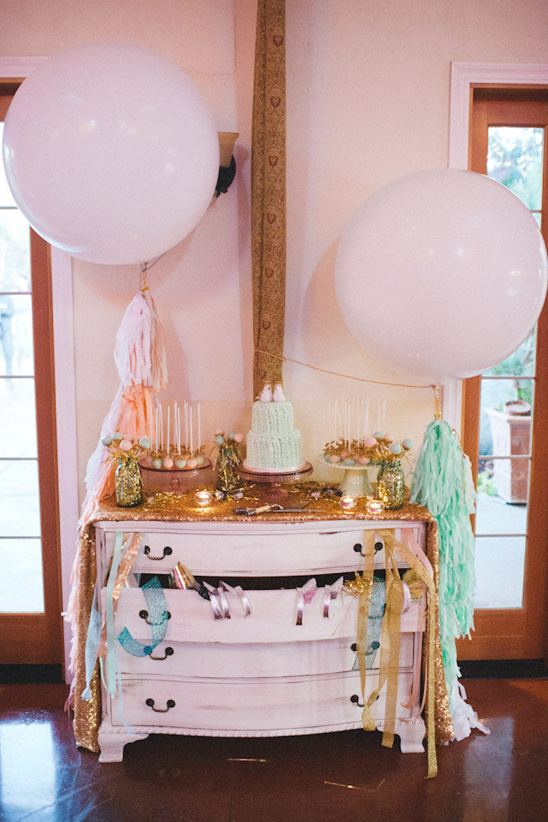 giant dessert table with balloons