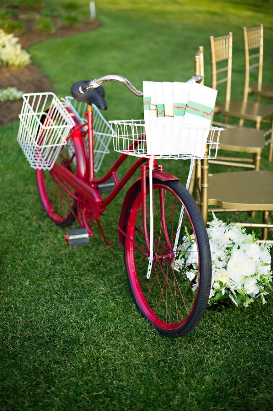 use a bike to hold your wedding programs