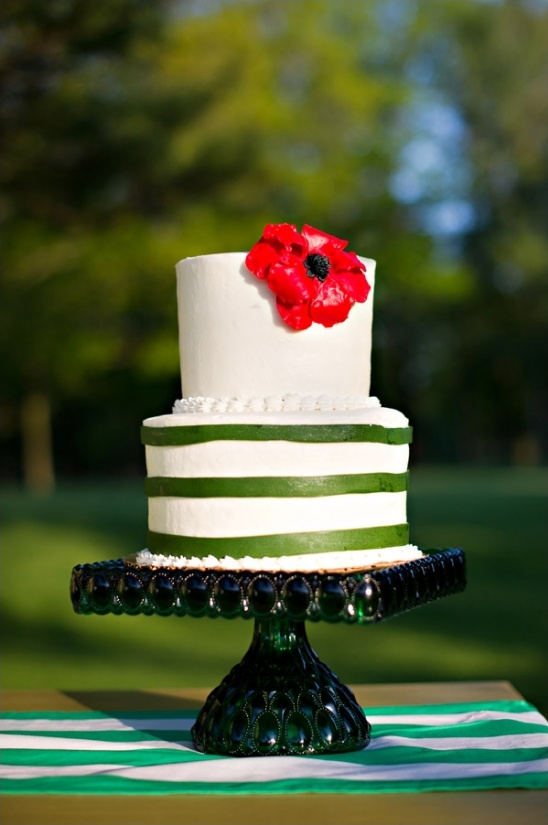 green and white wedding cake with red poppy by second floor bakery