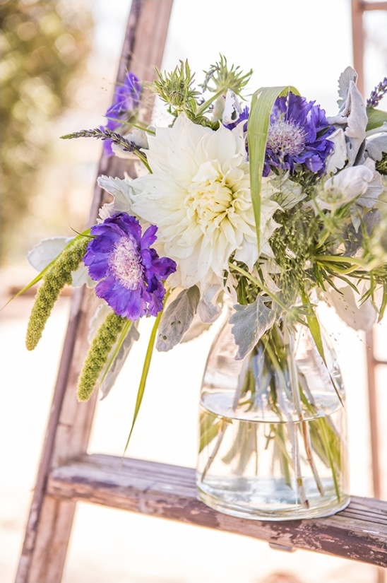 purple and white ceremony florals