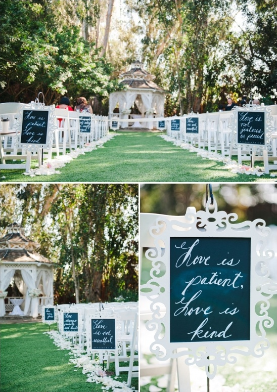 scripture written on chalkboard signs lining the ceremony aisle
