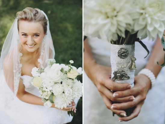 vintage brooches attached to bridal bouquet