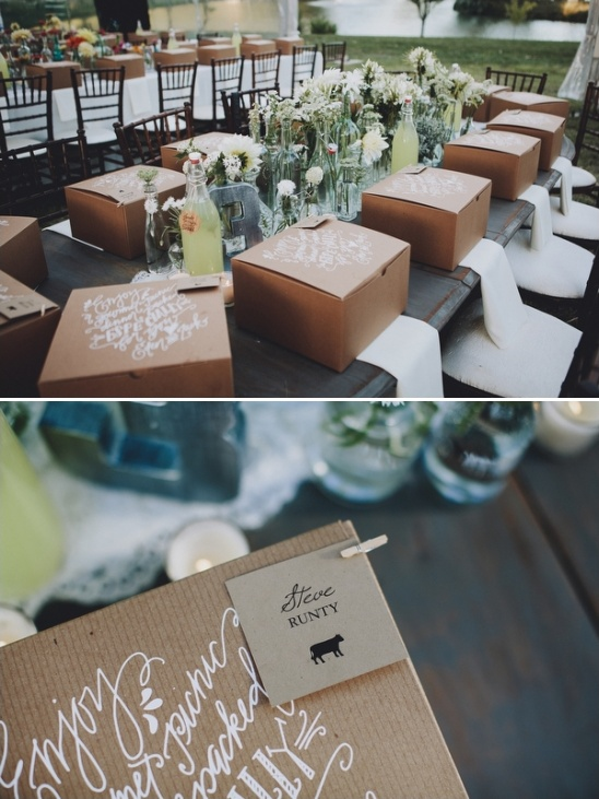wedding place cards attached to gourmet picnic dinner boxes