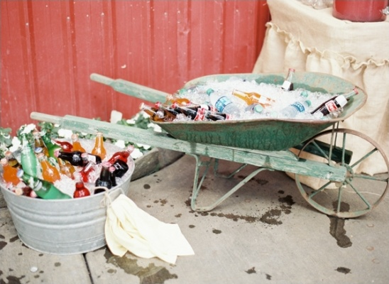 vintage wheelbarrow filled with ice to keep drinks cold