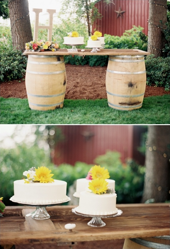 cake table created from an old door and wine barrels