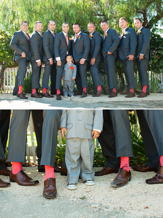 dark gray suits with red socks