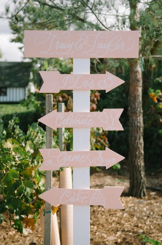pink and white wedding sign