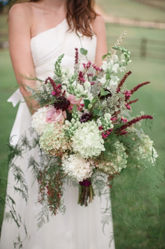 pink white and deep purple cascading bouquet by embellished blooms