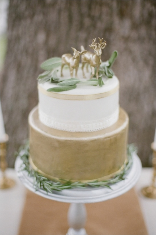 gold and white wedding cake with ribbon accents