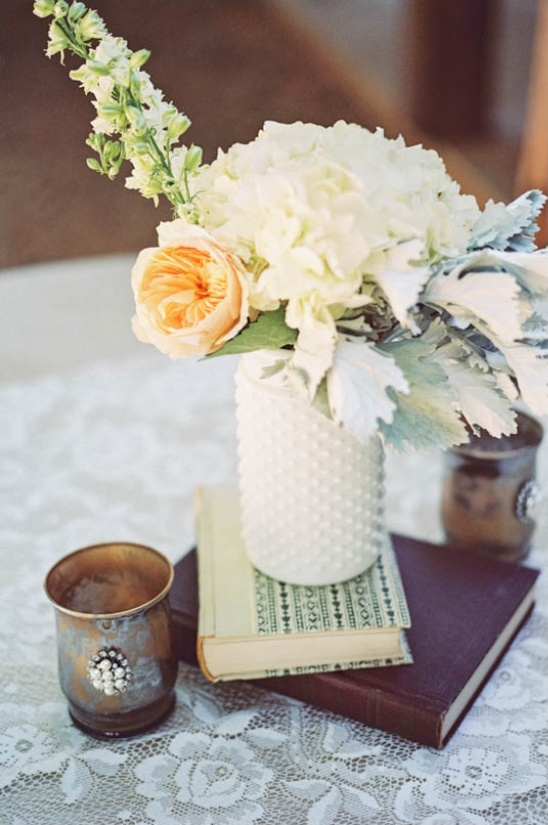white vase and antique book centerpiece