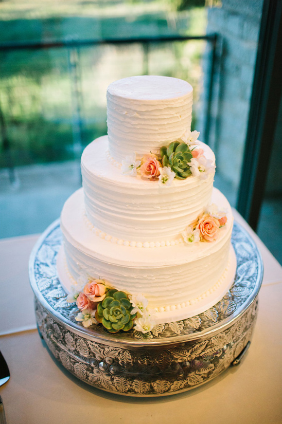three tier white wedding cake by blue note bakery